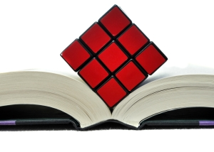 © Vlue | Dreamstime.com - Rubiks Cube On Open Book Photo